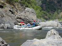 Raft Entering Stern Rapid on the Tuolumne River in California